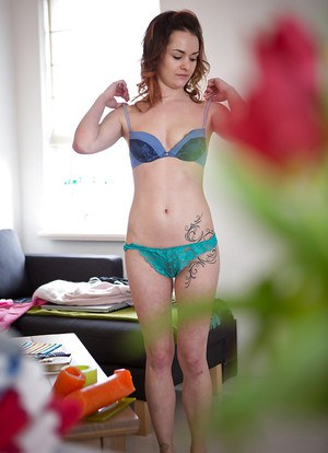 Petite girl with tattoos pulls on lace underwear as seen by hidden camera