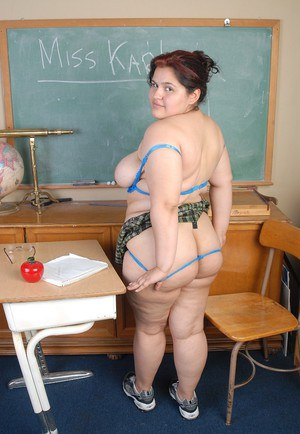 Fat chick Karla lifts schoolgirl skirt to masturbate in schoolroom