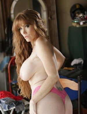 Busty mature pornstar Darla Crane posing in pretty pink panties