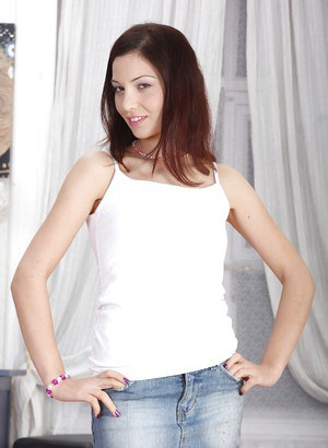 Petite brunette teen Jessica Malone showing off her small tits