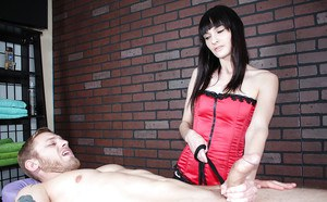 Petite BDSM brunette giving a guy a hardcore cock massage