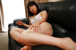 Asian housewife Aiko Kurita spreading her hairy Oriental vagina