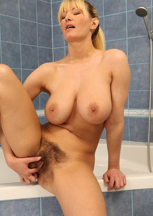 Buxom blonde lady Vanessa Lovely flaunting large all natural boobs