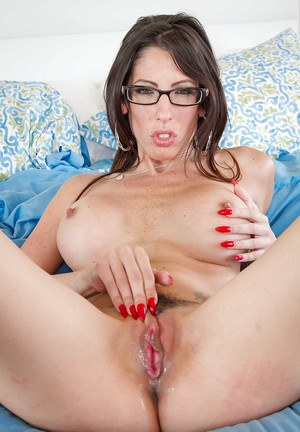 Busty brunette in glasses has nips sucked on while taking cumshot in pussy