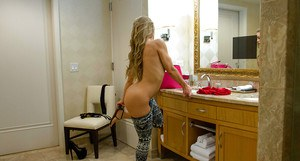 Hot blonde escort Nicole Aniston getting changed into hooker clothes