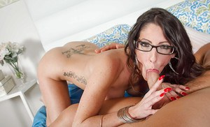 Busty brunette in glasses leaking cum from her hairy vagina