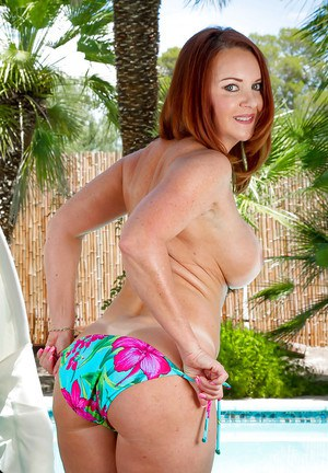 Mature redhead Janet Mason showcasing her hairy pussy and big boobs