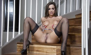 Busty brunette bombshell Abigail Mac spreading her legs in stockings