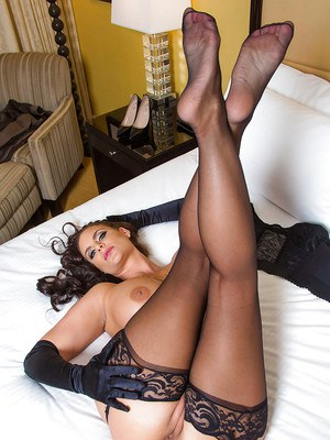 Curvy brunette Phoenix Marie showing off her gorgeous feet in stockings