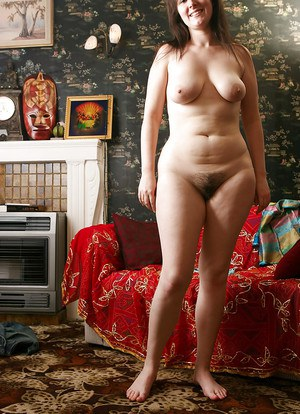Naturally busty amateur Claire M taking off her clothes and posing