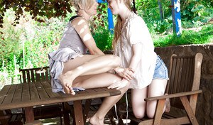 Trimmed amateur lesbians Laila and Satine getting dirty outdoors