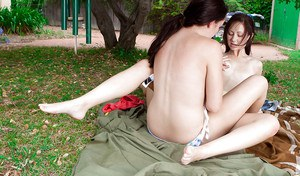 Young girls Hayley F and Jasmine making hot lesbian love outdoors