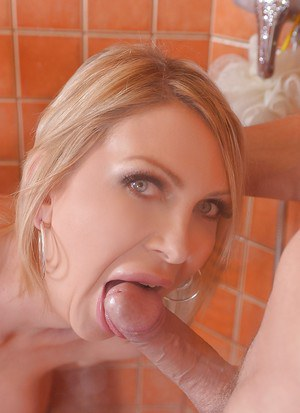 Gorgeous blonde MILF Leigh Darby sucking a dick in a shower