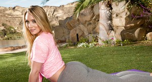Blond babe AJ Applegate works out in yoga pants outdoors before stripping