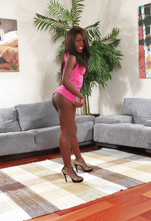 Ebony pornstar Whitney William shows off her young black girl's naked body