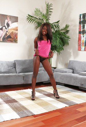 Ebony teen Whitney William posing sexily in pretty pink top and panties