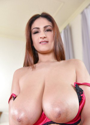 Busty chick Sandra Milka posing solo in nylons and lingerie