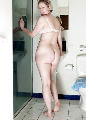 Blonde BBW Zita undresses in bathroom and takes hairy cunt to the shower
