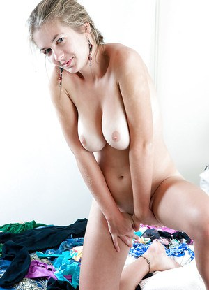 Beautiful young blonde Shelley strips naked and flaunts all natural tits