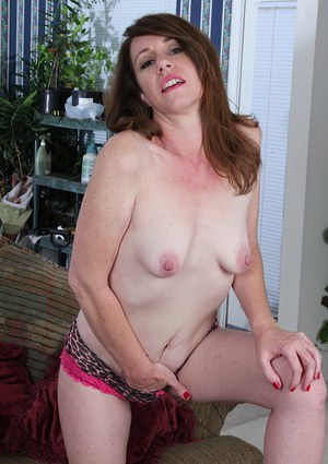 Experienced woman Joanie Bishop removes bra and panties for masturbation