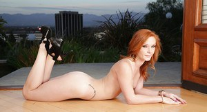 Adorable redhead pornstar Alex Tanner showing off her ass in high heels