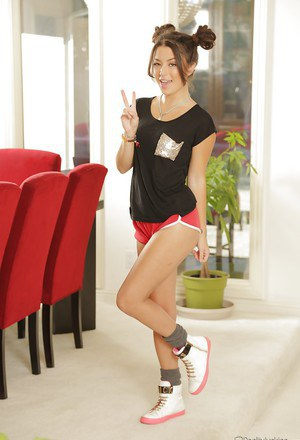 Beautiful Asian babe Daisy Haze showing off her round ass in shorts