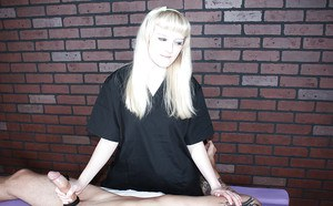 Wicked blonde lady gives tattooed man a kinky handjob during massage