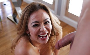 Stunning Asian mature Mia Lelani giving a titjob and sucking cock
