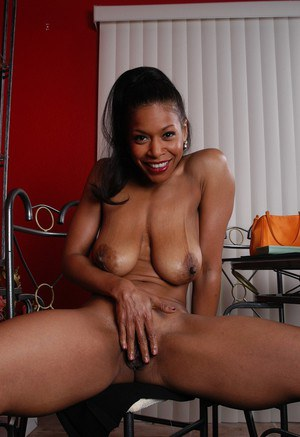 Mature ebony model spreads older black pussy lips for nice clit viewing