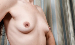 Mature lady Sable Renae baring small tits and hairy pussy