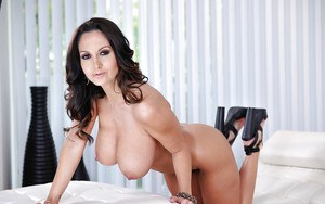 Buxom MILF Ava Addams peels off bra and panties to model naked