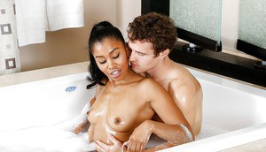 Sexy black girl Yasmine de Leon fucking white guy in bathtub