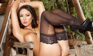 Hot babe Anita Serena posing solo outdoors in stockings and high heels