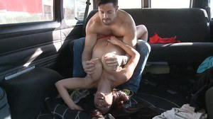 Busty babe gets fucked in backseat of car and has face covered in cum