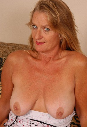 Older blonde woman Vickie letting her saggy tits loose from top