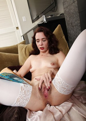 Older broad Sable Renae fingering her hairy vagina beside fireplace