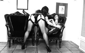 Busty MILF lesbians in vintage stockings and boots licking pussy
