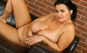 Chubby older lady Reny letting her big boobs loose and masturbating