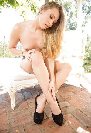 Pretty mom AJ Applegate strips naked outdoors and exposes shaved pussy