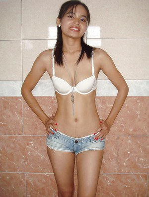 Thai hottie gets naked by removing short shorts and white bra in bathroom