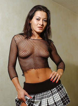 Brunette Sandra Romain posing in see thru mesh top and schoolgirl skirt