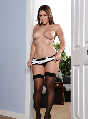 Busty maid Valentina Nappi exposing large tits in nylons and high heels