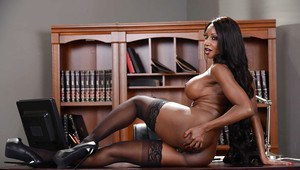 Busty ebony MILF Diamond Jackson poses solo with fingers in black cunt