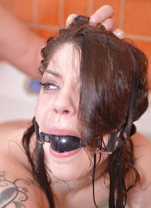Gagged and bound fetish model Lucia Love has her asshole fisted by man
