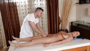 Buxom European babe Sensual Jane enjoys hot oil massage of huge hooters