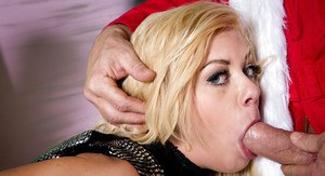 Blonde pornstar Riley Steele eats cum off of her slutty face