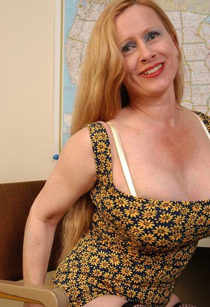 Buxom mature secretary Lavender lets her huge tits loose at work
