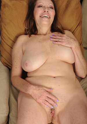 Tasty big tit MILF Jane McWilliams playing with herself on a sofa