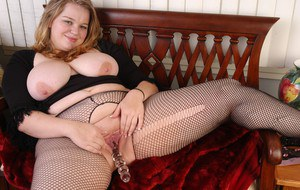 Chubby blond Lona uses fingers and glass dildo to masturbate BBW pussy