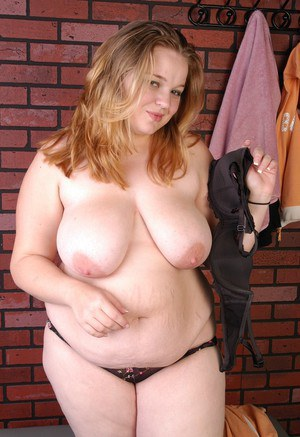 BBW Lona strips off workout uniform to model in bra and panties